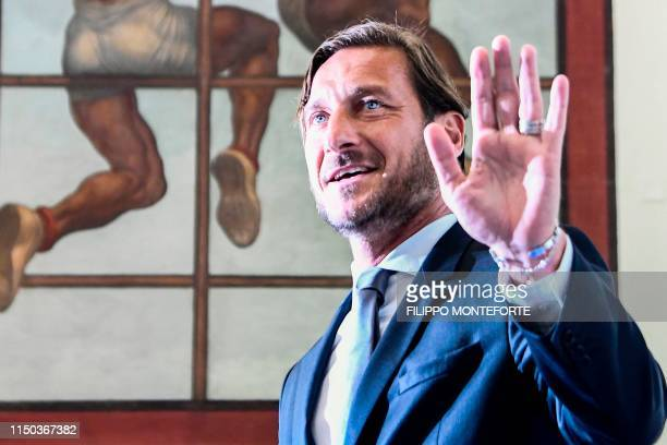 Italian former professional footballer and current technical director at AS Roma, Francesco Totti waves as he arrives for a press conference on June...