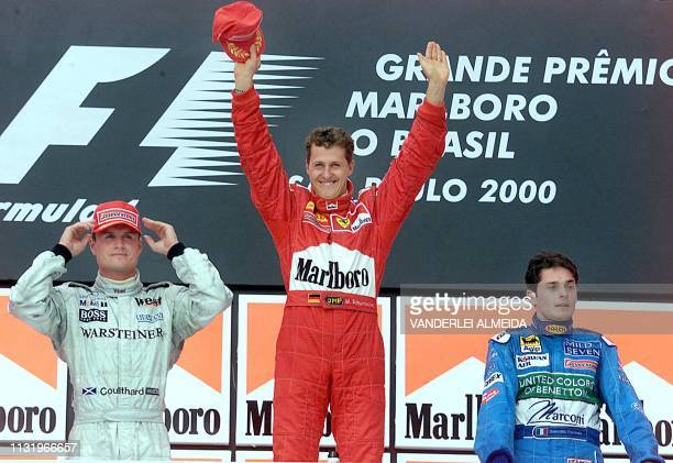 Italian Formula One driver Giancarlo Fisichella of Benetton German Formula One world champion Michael Schumacher of Ferrari and British David...