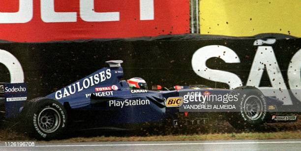 Italian Formula One driver Jarno Trulli looses the control of his ProstPeugeot during a practice session at the Interlagos race track 09 April 1999...