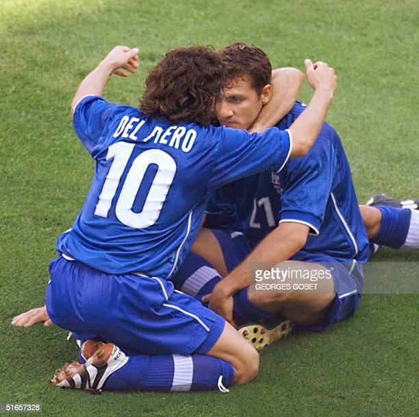 Italian forward Alessandro Del Piero congratulates team-mate and forward forward Christian Vieri after Vieri scored the first goal 27 June at the...