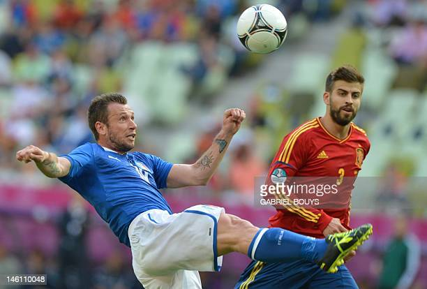 Italian forward Antonio Cassano eyes the ball next to Spanish defender Gerard Pique during the Euro 2012 championships football match Spain vs Italy...