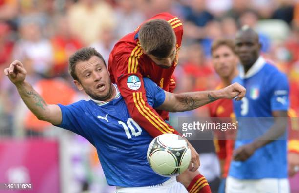 Italian forward Antonio Cassano vies with Spanish defender Gerard Pique during the Euro 2012 championships football match Spain vs Italy on June 10...