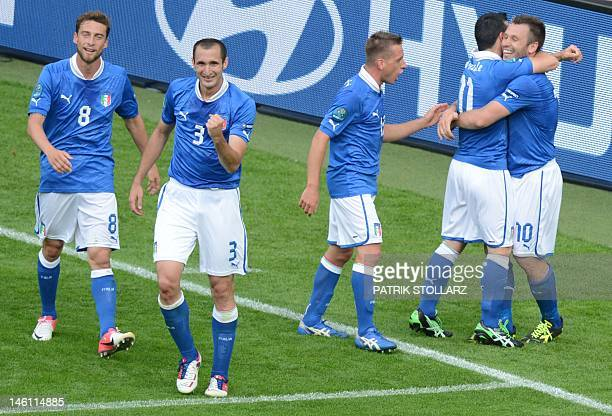 Italian forward Antonio Di Natale is congratulated by teammates during the Euro 2012 championships football match Spain vs Italy on June 10 2012 at...