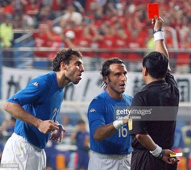 Italian forward Christian Vieri and teammate Angelo Di Livio argue with referee Byron Moreno as he gives out a red card to Italian forward Francesco...