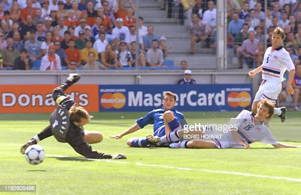Italian forward Christian Vieri scores past Norwegian goalkeeper Frode Grodas 27 June at the Stade Velodrome in Marseille, south of France, during...