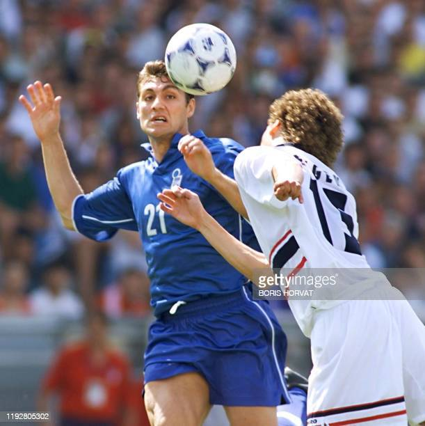 Italian forward Christian Vieri , who scored the 1-0 lead, and Norwegian defender Dan Eggen leap for a ball 27 June at the Stade Velodrome in...
