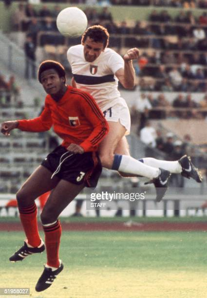 Italian forward Luigi Riva jumps over Haitian defender Arsene Auguste as he heads the ball during the World Cup first round match between Italy and...