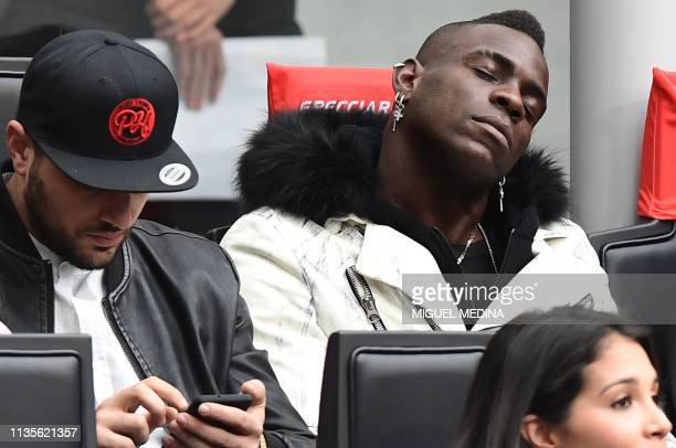 Italian forward Mario Balotelli takes a nap during the Italian Serie A football match Inter Milan vs Atalanta Bergamo on April 7 2019 at the San Siro...