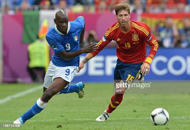 Italian forward Mario Balotelli vies with Spanish defender Sergio Ramos during the Euro 2012 championships football match Spain vs Italy on June 10...