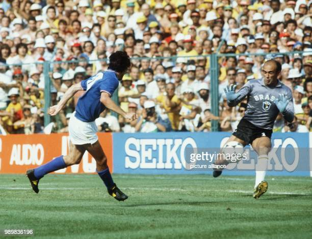 Italian forward Paolo Rossi suddenly finds himself alone in front of Brazilian goalkeeper Valdir Peres who can clear the attack. The Italian national...