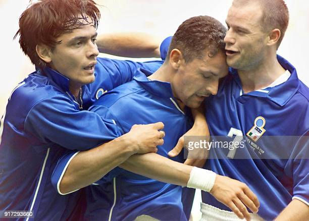 Italian forward Roberto Baggio is congratulated by teammates Filippo Inzaghi and Gianluca Pessotto after scoring a goal 23 June at the Stade de...