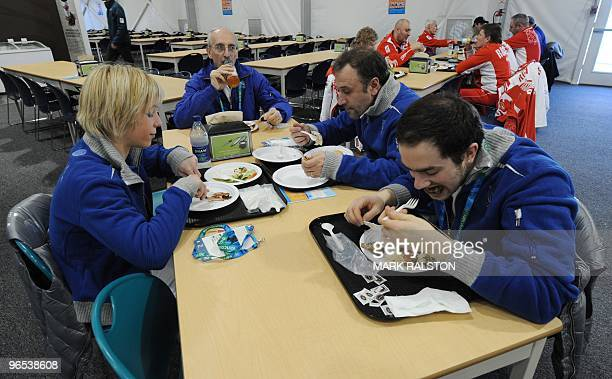 Italian Freestyle skiers eat in the Winter Olympic athletes dining hall during a media tour at the Olympic Village in downtown Vancouver on February...