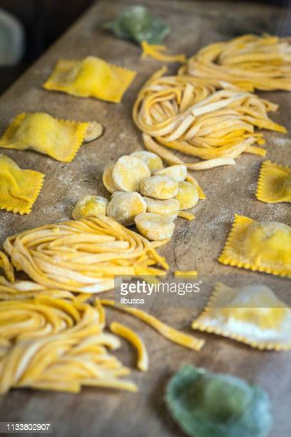italian fresh pasta and tortellini ravioli - pasta stock pictures, royalty-free photos & images
