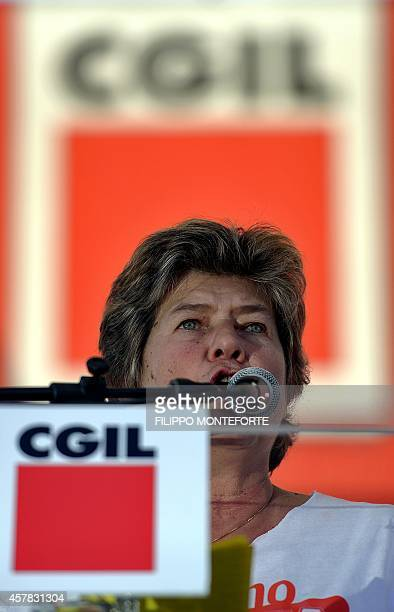 Italian General Confederation of Labour union leader Susanna Camusso talks to demonstrators during a rally organised by the union on October 25 2014...