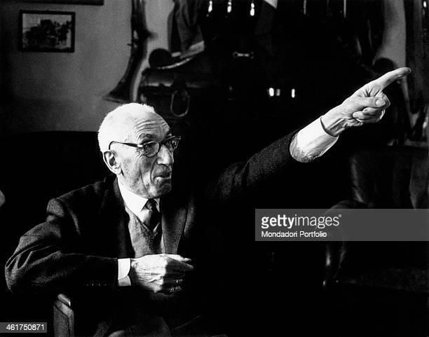 Italian general Raffaele Cadorna sitting pointing his finger forward. Cadorna didn't attended the twentieth anniversary celebration of the Resistenza...