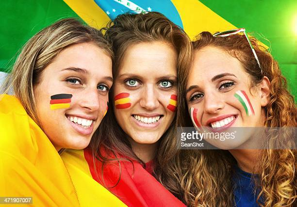 Italian, German and Spanish Fans. Brazilian Flag in the Background.