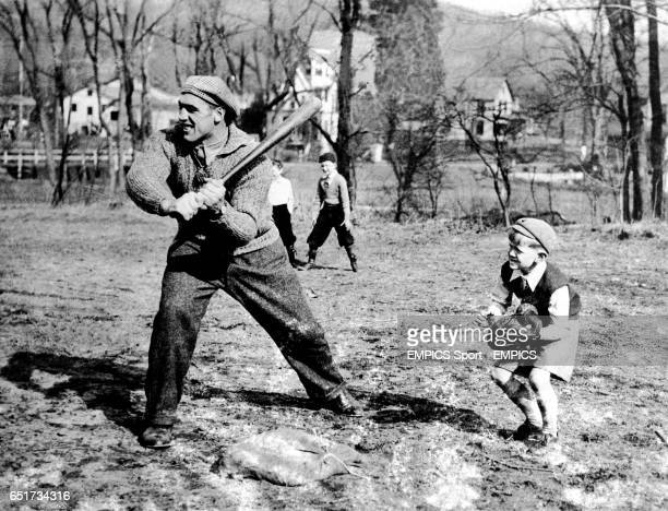 Italian giant Primo Carnera joins in a juvenile baseball game in Orangeburg New York during training for his fight against Ray Impellettiere at...