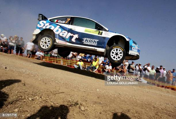 Italian Gigi Galli with codriver Giovanni Bernacchini drive their Ford Focus RS WRC during the 'Shimatari' special stage on the first day of the...