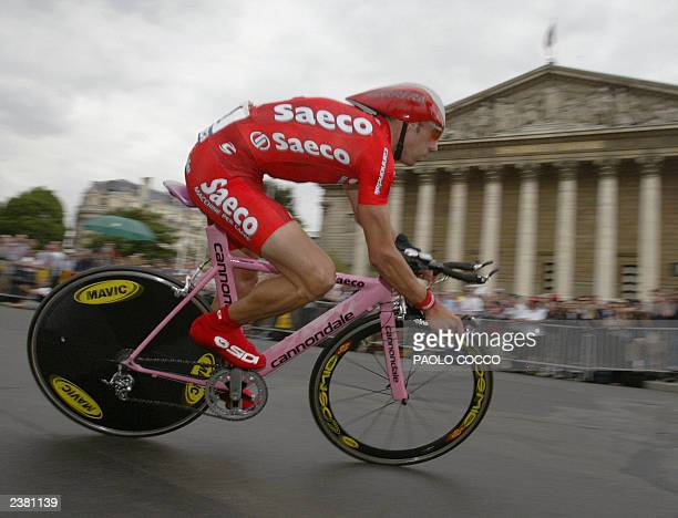 Italian Gilberto Simoni takes a curve in front of the National Assembly during the prologue of the 90th Tour de France a time trial in Paris 05 July...