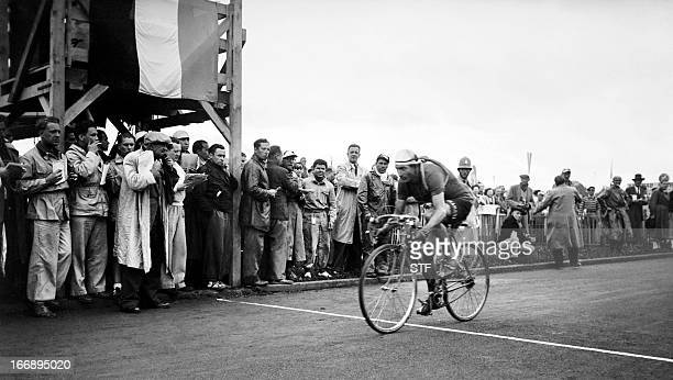 Italian Gino Bartali crosses the finish line to win the 15th stage of the Tour de France between AixlesBains and Lausanne on July 18 1948 Bartali won...