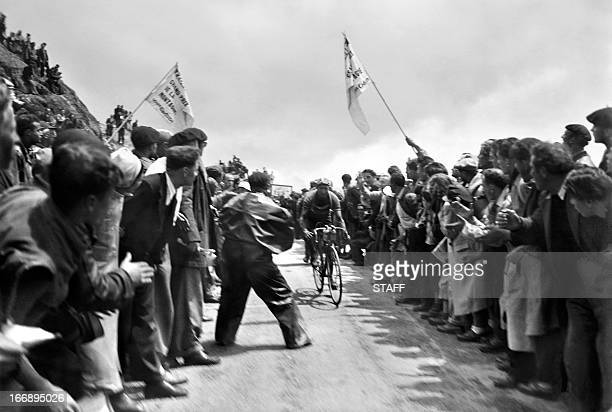 Italian Gino Bartali rides uphill in the Col de la CroixdeFer on his way to winning the 14th stage of the Tour de France between Briançon and...