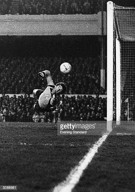 Italian goalkeeper Dino Zoff dives for the ball