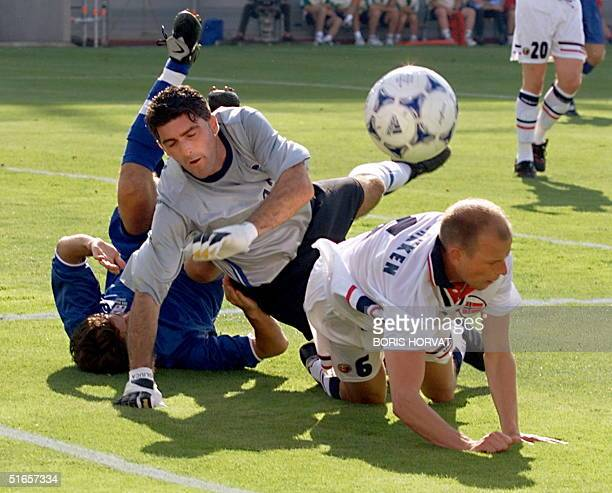 Italian goalkeeper Gianluca Pagliuca , defender Alessandro Costacurta and Norwegian midfielder Stale Solbakken fall 27 June during the 16th Soccer...