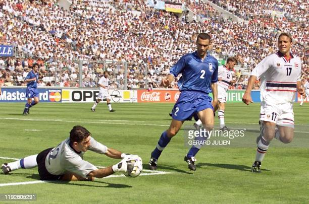 Italian goalkeeper Gianluca Pagliuca dives to stop the ball as teammate Giuseppe Bergomi and Norwegian Havard Flo look on, 27 June at the Stade...