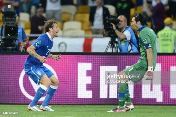 Italian goalkeeper Gianluigi Buffon and Italian midfielder Antonio Nocerino celebrate after winning the Euro 2012 football championships...