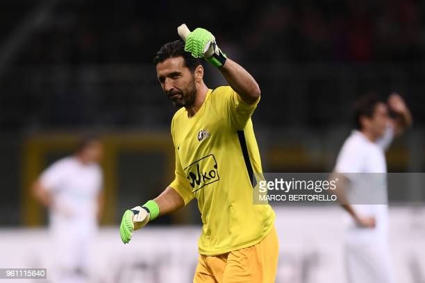 Italian goalkeeper Gianluigi Buffon gestures during the 'Notte del Maestro' a football match celebrating the end of former Italy's football player...