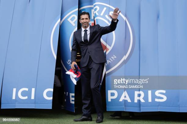 TOPSHOT Italian goalkeeper Gianluigi Buffon poses for the press on July 9 2018 at the Parc des Princes stadium in Paris after French Ligue 1 football...