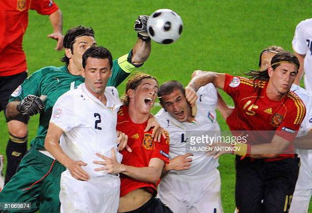 Italian goalkeeper Gianluigi Buffon punches the ball away from Italian defender Christian Panucci Spanish forward Fernando Torres Italian defender...