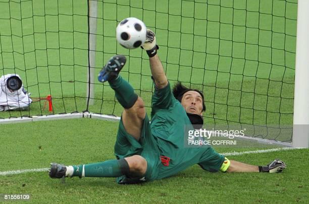 Italian goalkeeper Gianluigi Buffon saves a penalty shot by Romanian forward Adrian Mutu during the Euro 2008 Championships Group C football match...
