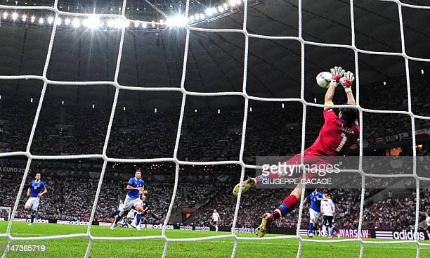 Italian goalkeeper Gianluigi Buffon saves a shot by German midfielder Sami Khedira during the Euro 2012 football championships semifinal match...