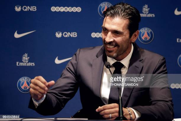 Italian goalkeeper Gianluigi Buffon smiles as he speaks during a press conference on July 9 2018 at the Parc des Princes stadium in Paris after...