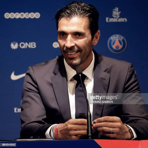 Italian goalkeeper Gianluigi Buffon smiles during a press conference on July 9 2018 at the Parc des Princes stadium in Paris after French Ligue 1...