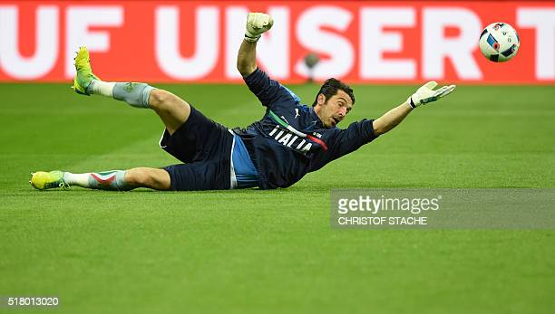 Italian goalkeeper Gianluigi Buffon warms up prior the friendly football match between Germany and Italy in the stadium in Munich southern Germany on...