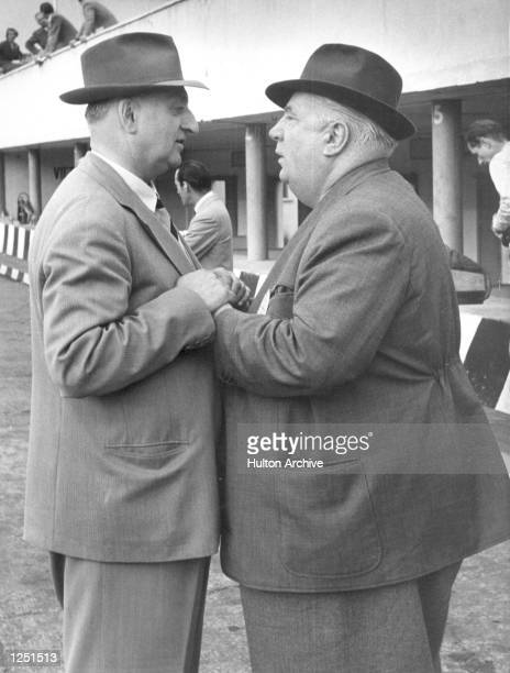 Italian Grand Prix Monza Motor Racing supremos Enzo Ferrari and Dr Alfred Neubauer of Mercedes Benz chat in the pits during practice for the race It...