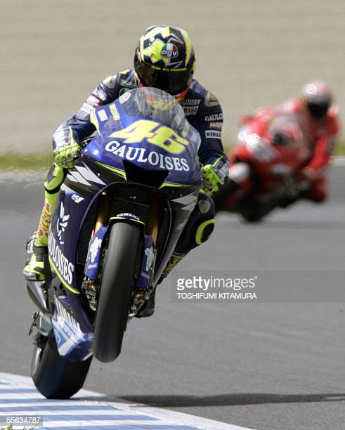 Italian Grand Prix rider Valentino Rossi rides in his Yamaha after the second free practice session of the MotoGP class in the Japanese Grand Prix at...