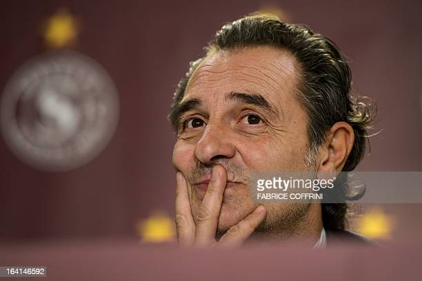 Italian head coach Cesare Prandelli adjusters his during a press conference on March 20 2013 in Geneva on the eve of a friendly football match...