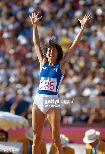 Italian high jumper Sara Simeoni celebrates after being awarded the silver medal in the final of the Women's high jump event at the 1984 Summer...
