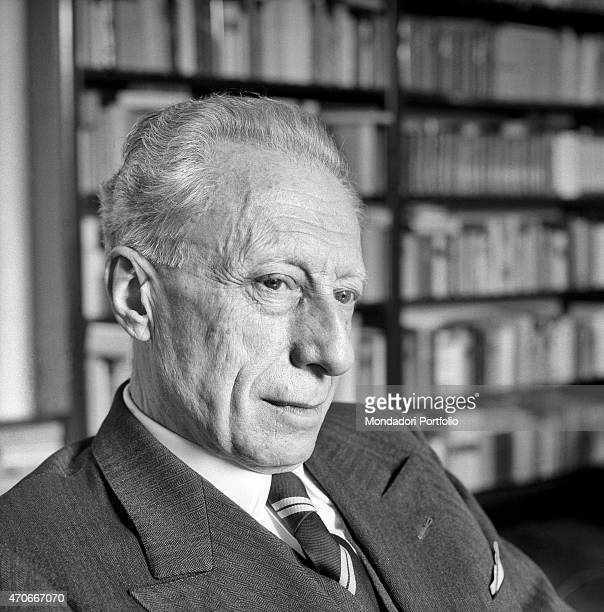 'Italian historian Mario Vinciguerra is shot closeup while he is gazing into the distance inside his study he is also a prominent journalist writer...