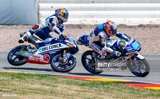 Italian Honda rider Fabio Di Giannantonio falls next to Spanish Honda rider Jorge Martin at the Grand Prix of Germany at the Sachsenring Circuit on...