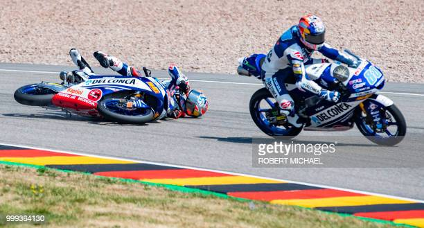 Italian Honda rider Fabio Di Giannantonio falls next to Spanish Honda rider Jorge Martin at the Grand Prix of Germany at the Sachsenring Circuit on...