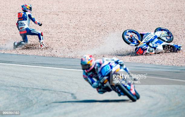 TOPSHOT Italian Honda rider Fabio Di Giannantonio falls next to Spanish Honda rider Jorge Martin at the Grand Prix of Germany at the Sachsenring...
