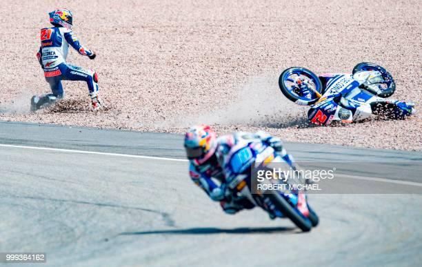 TOPSHOT Italian Honda rider Fabio Di Giannantonio falls next to Spanish Honda rider Jorge Martin at the Grand Prix of Germany at the Sachsenring...
