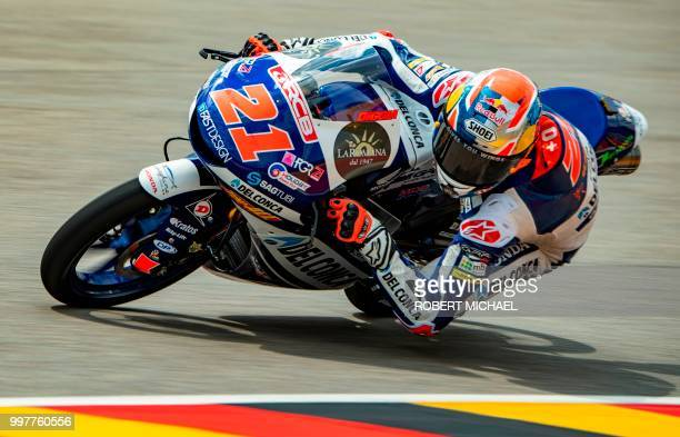 Italian Honda rider Fabio Di Giannantonio steers his bike during the second training session of the Moto3 to the second training session of the Moto3...