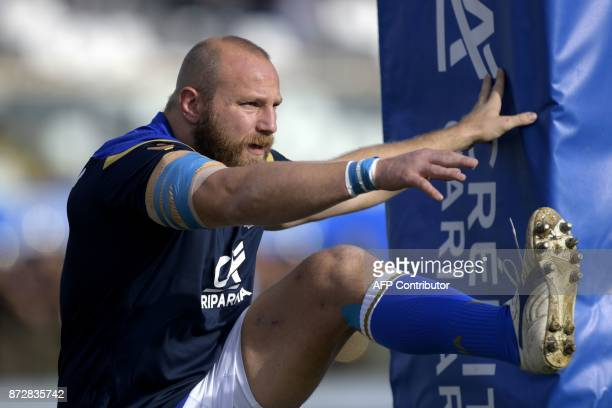 Italian hooker Leonardo Ghiraldini warms up prior to a Rugby Union test match between Italy and Fiji at the Angelo Massimino stadium in Catania on...