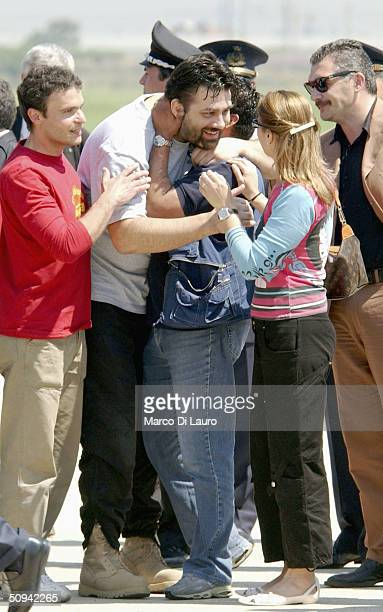 Italian hostage Maurizio Agliana is greeted by his sister Antonella as he arrives at Ciampino Military airbase on June 9 2004 in Rome Italy The three...