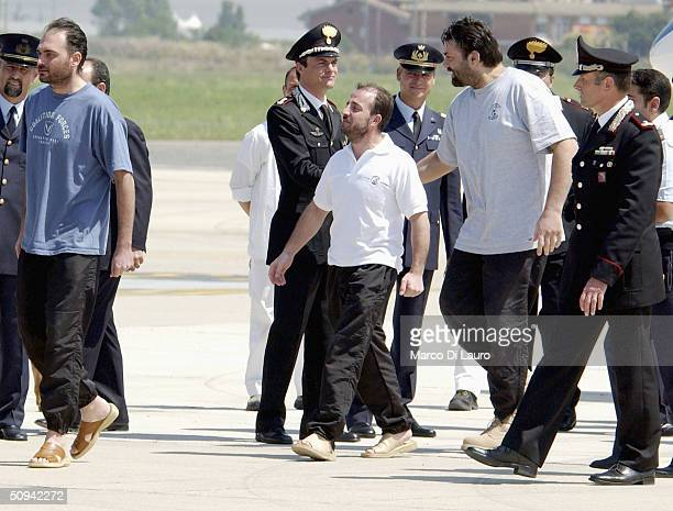 Italian hostages Salvatore Stefio Umberto Cupertino and Maurizio Agliana arrive at Ciampino Military airbase on June 9 2004 in Rome Italy The three...